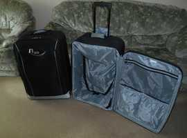 two black expandable suitcases