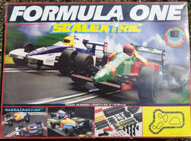 Vintage Formula One Scalextric Racing Car Set C439, in good condition for its age.