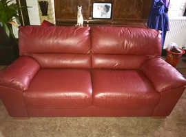 Two two seaters in leather one is slightly larger than other
