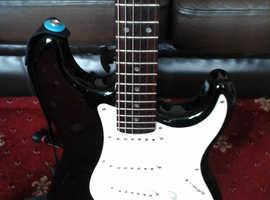 Fender Squier Affinity Stratocaster (with padded gig bag).