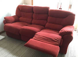 Very comfortable red three seater sofa with end recliners