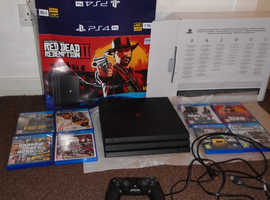 Playstation PS4 Pro 1TB (Only 2 months old) with 8 games - like new