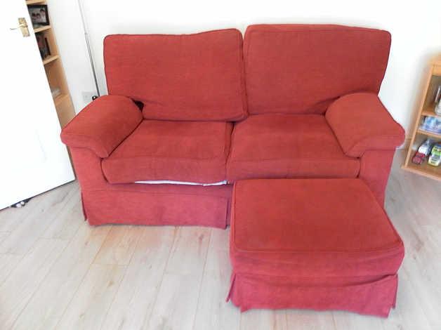 Red 2 seater sofa & foot stool set. in Southampton