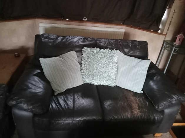 Black leather sofas in Lowestoft